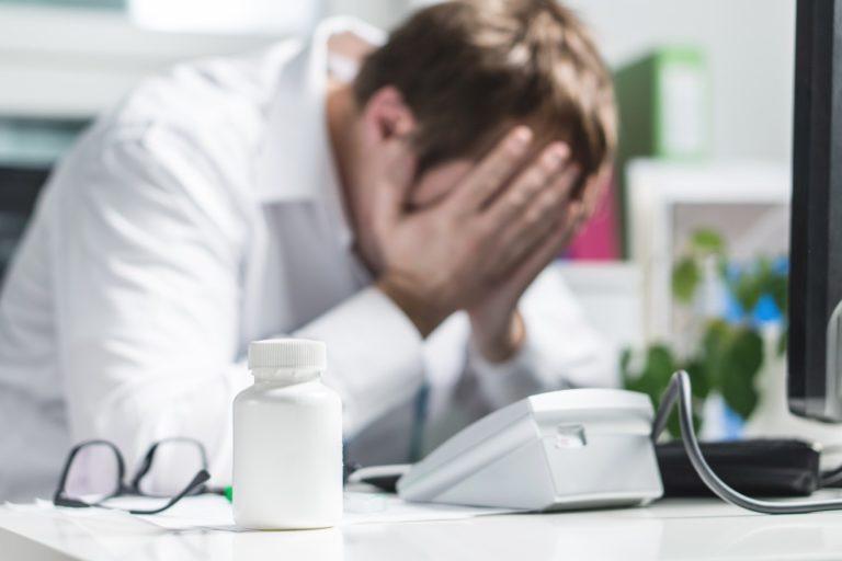 man feeling stressed at work