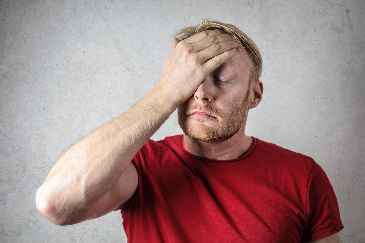 sad man wearing a red shirt