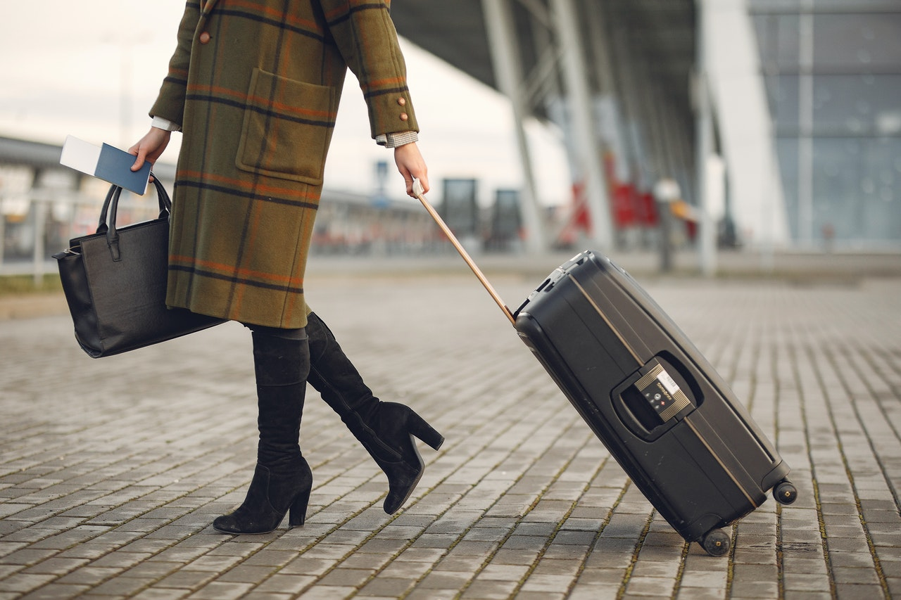 woman holding her luggage