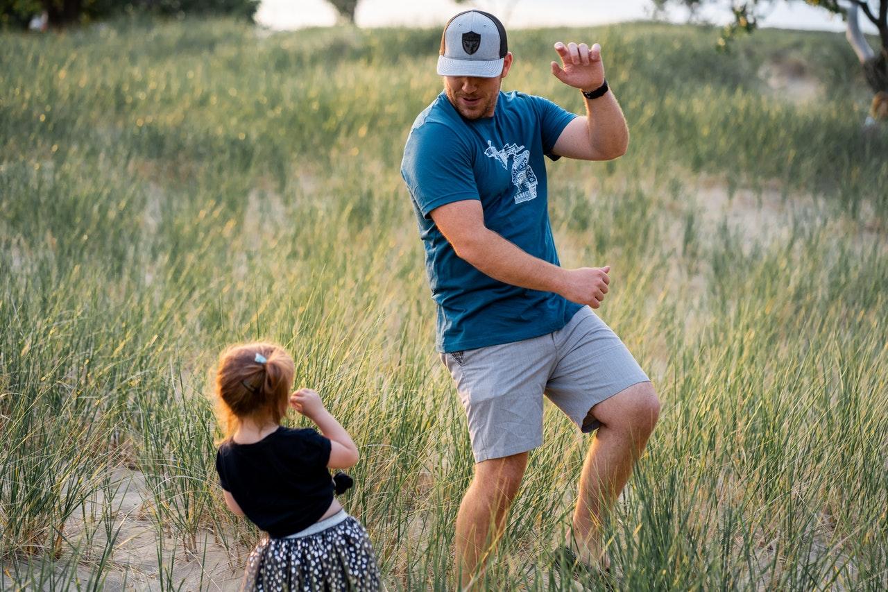 man dancing with his daughter