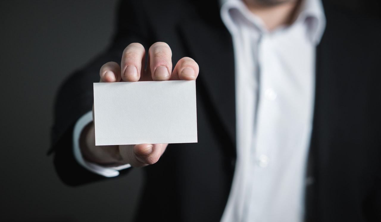 man holding an empty business card
