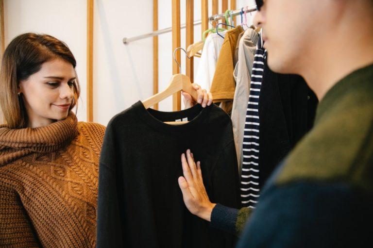 woman holding a shirt