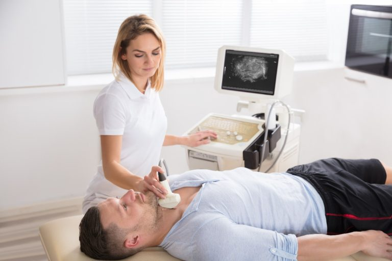man getting a check up